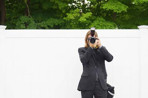 photo clothing person in black suit jacket using DSLR camera coat free for commercial use images