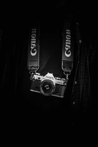 photo black-and-white gray and black Canon camera body with lanyard camera strap free for commercial use images
