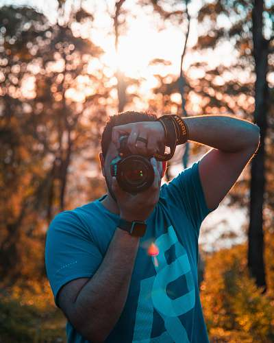 person man using DSLR camera human