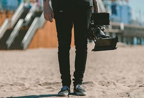 photo shoe person holding shoulder-mount camcorder video free for commercial use images