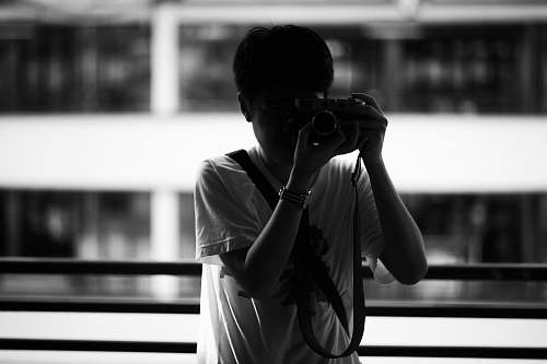 photo person grayscale photography of person holding camera black-and-white free for commercial use images