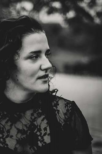 black-and-white grayscale photography of woman wearing lace short-sleeved top face