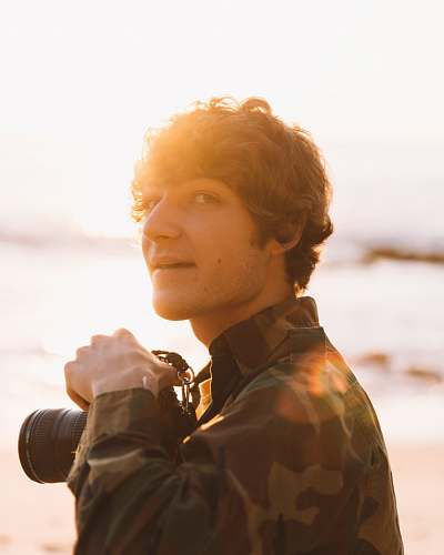 person smiling man holding camera close-up photography photographer
