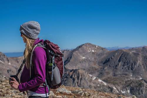 mountain woman hiking on mountain mountain range