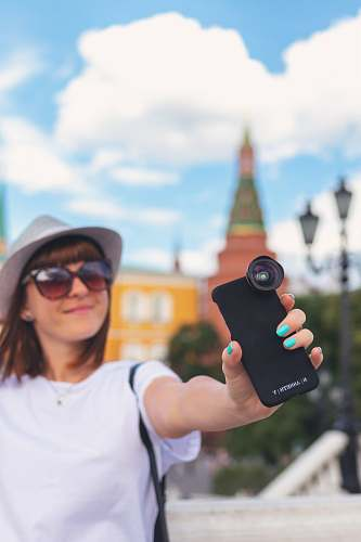 person woman holding black smartphone accessories