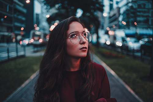person woman in maroon sweater with eyeglasses accessories