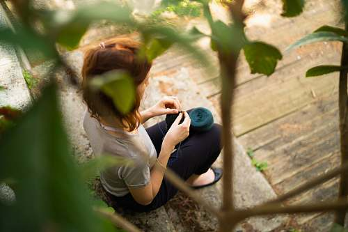 photo person woman siting on focus photography outdoors free for commercial use images