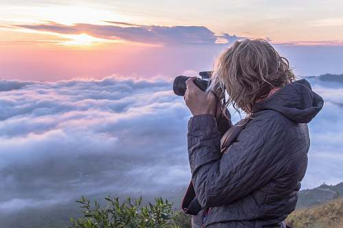 person woman taking photo of clouds mount batur