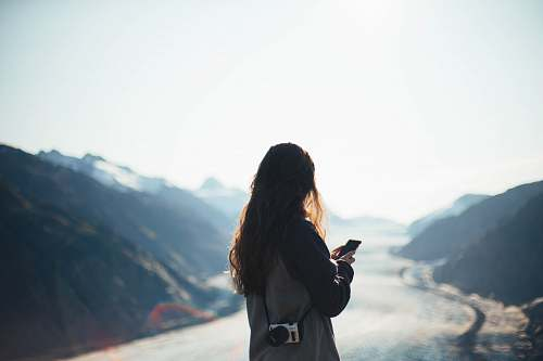 person woman using smartphone outdoors photo