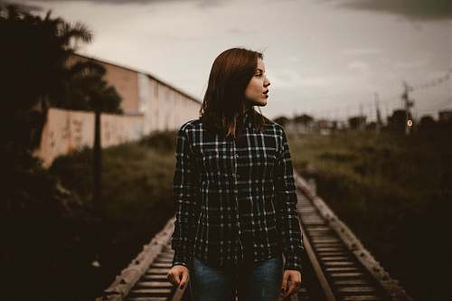 photo person woman standing on train rail track human free for commercial use images