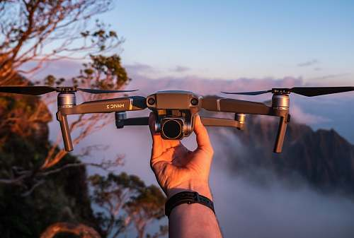 photo human gray drone photography free for commercial use images