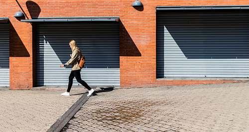 people man walking on running bone pavement walking
