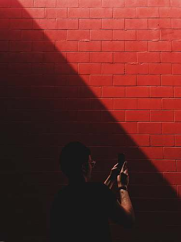 human person capturing red brick red