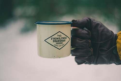 human person holding white ceramic mug people