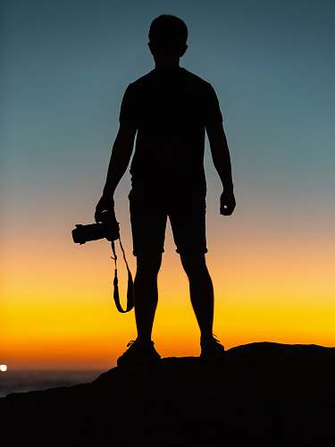photo silhouette silhouette of man standing on cliff human free for commercial use images