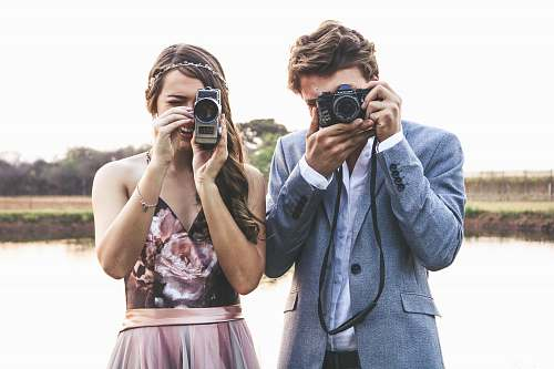 photo human woman and man holding cameras mobile phone free for commercial use images