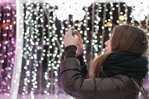 photo girl woman in black scarf using smartphone scarf free for commercial use images