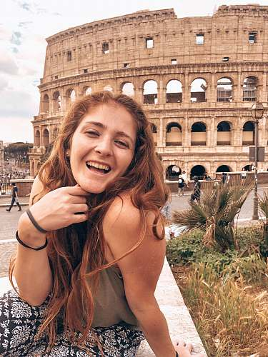 human woman smiling near coliseum face