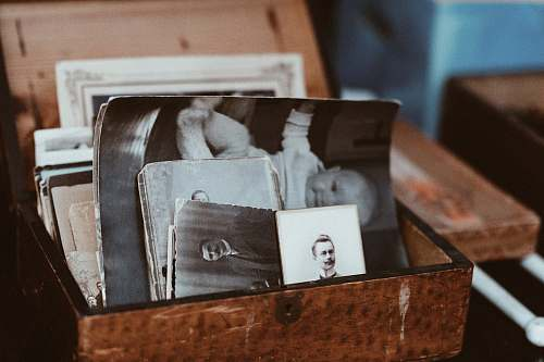 vintage old photos in brown wooden chest pictures