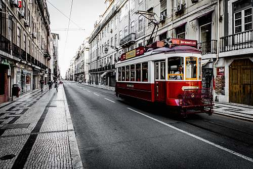 tram white and red vehicle on road streetcar