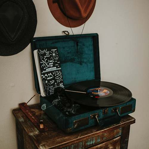 photo rust black and blue turntable on brown wooden side table record free for commercial use images