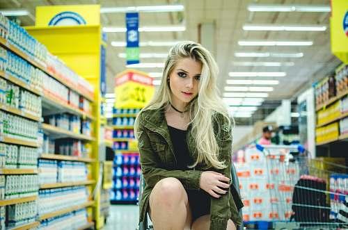 girl woman sitting beside grocery female
