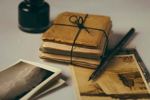 vintage brown paper and black pen photos