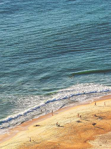 ocean people standing in seashore aerial photography sea