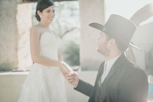 apparel wedding couple on focus photography hat