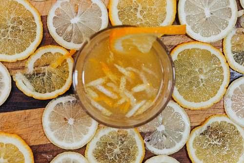fruit full drinking glass surrounded with lemon slices citrus fruit