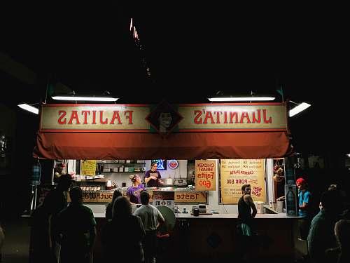 people Juanitas Fajitas store during night time human