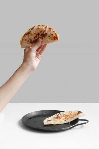 human person holding pancake raising it up food