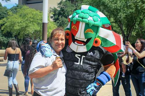 human woman standing beside sports mascot apparel
