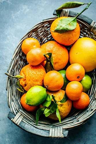 fruit orange and lemon fruits on gray wicker basket citrus fruit