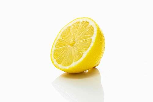 fruit yellow lemon fruit on white surface citrus fruit