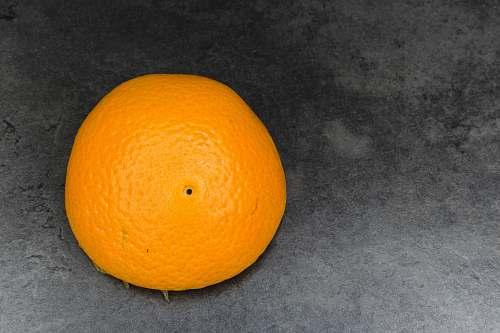 food orange fruit on gray textile orange