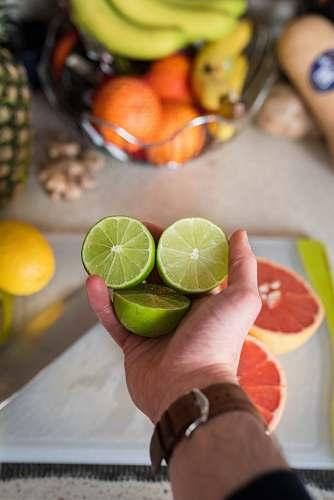 food person holding sliced lemon fruit citrus fruit