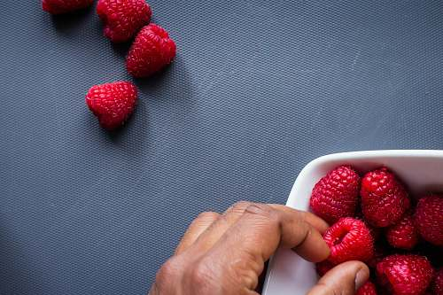 food red strawberries in white plastic container plant