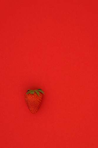 strawberry red strawberry fruit on red surface food