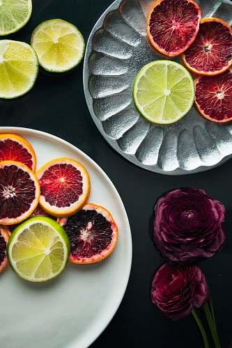 food sliced lemon on white ceramic plate citrus fruit