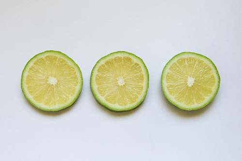 food sliced lemon on white surface citrus fruit