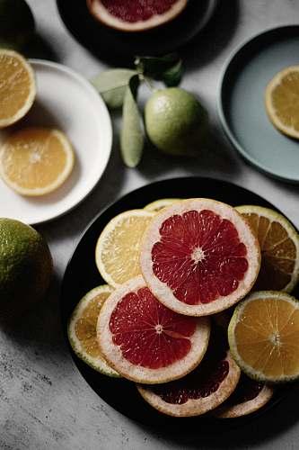 food sliced orange fruit on black ceramic plate citrus fruit