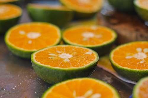 food sliced orange fruit on brown wooden table orange