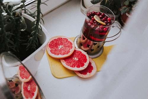 food sliced orange fruit on white plate citrus fruit