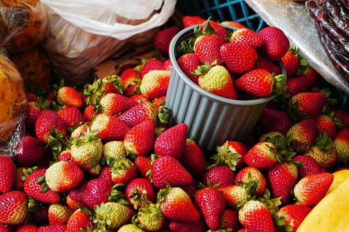 food strawberries in brown woven basket strawberry