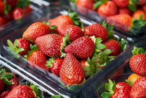 food strawberries on clear plastic container strawberry