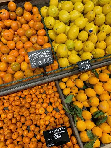 food yellow and orange fruits on brown wooden crate citrus fruit