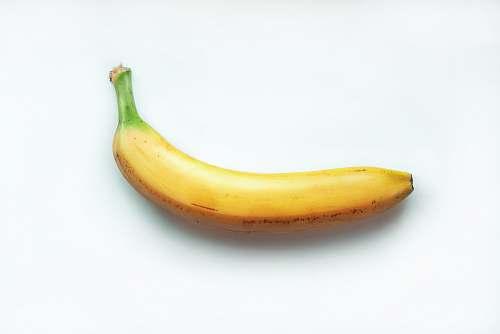 food yellow banana on white surface banana