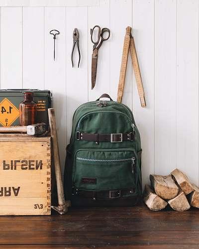 bag green backpack near wall venice