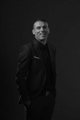 apparel grayscale photography of man wearing black tuxedo suit